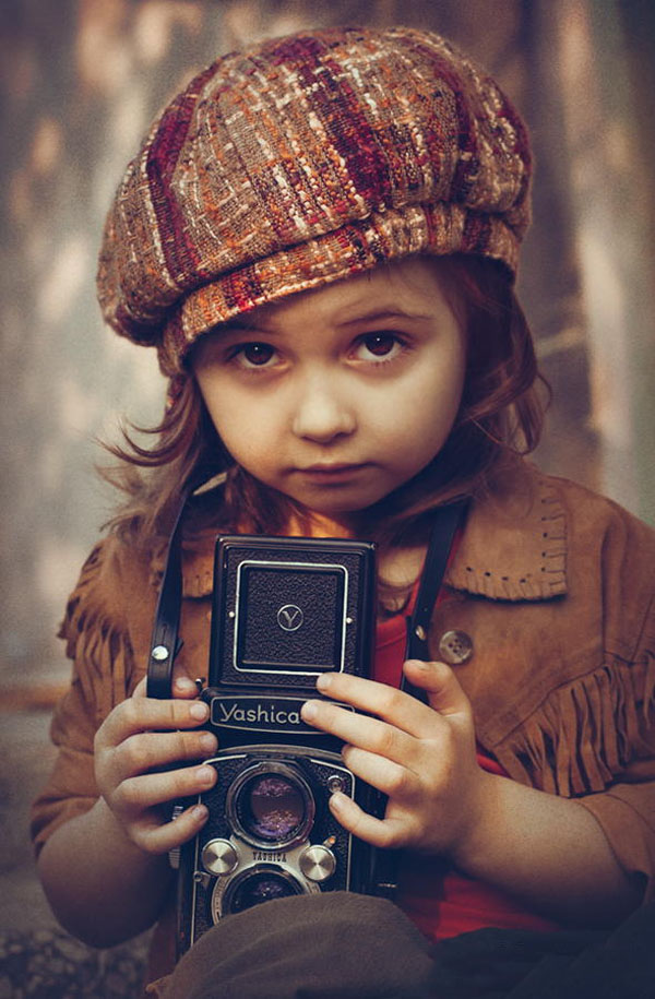 kid-holding-camera-photo-12